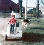 Sitting in Grandma's golf cart - this is how to travel around the farm!