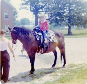 Mom's trying to teach me to ride a horse - good luck!