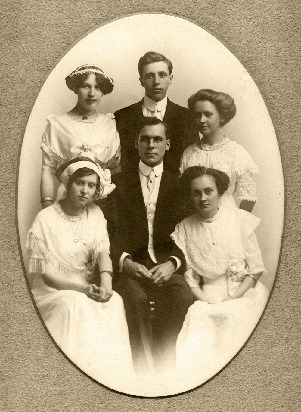 Top Left: Viola Bausman. Viola would have been about 19 years old. Written on back, in pencil (not Viola's handwriting): Earl Rummel, Alta Phillips Pierson, Lucille Roberts, Rosella Bird Schalk. The man in the middle is not identified, but think he was probably their teacher. Assume this is the Scales Mound High School Senior Class picture since they all graduated that year.